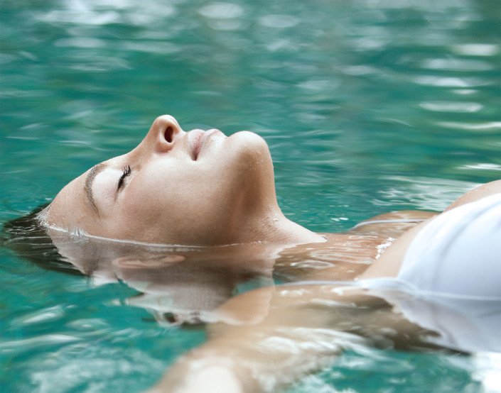 woman relaxed while floating on back